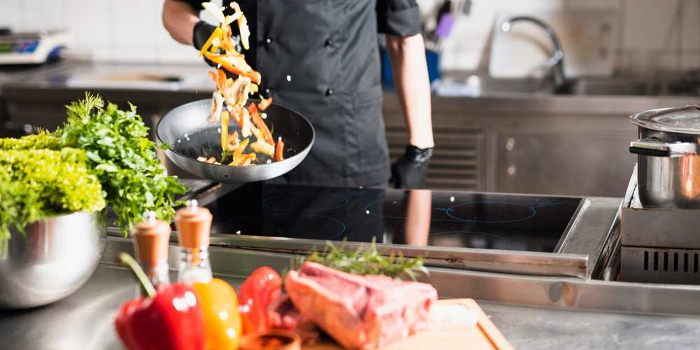 A Chief is Stir-frying Bell Peppers with O-Grill Professional Culinary Torches